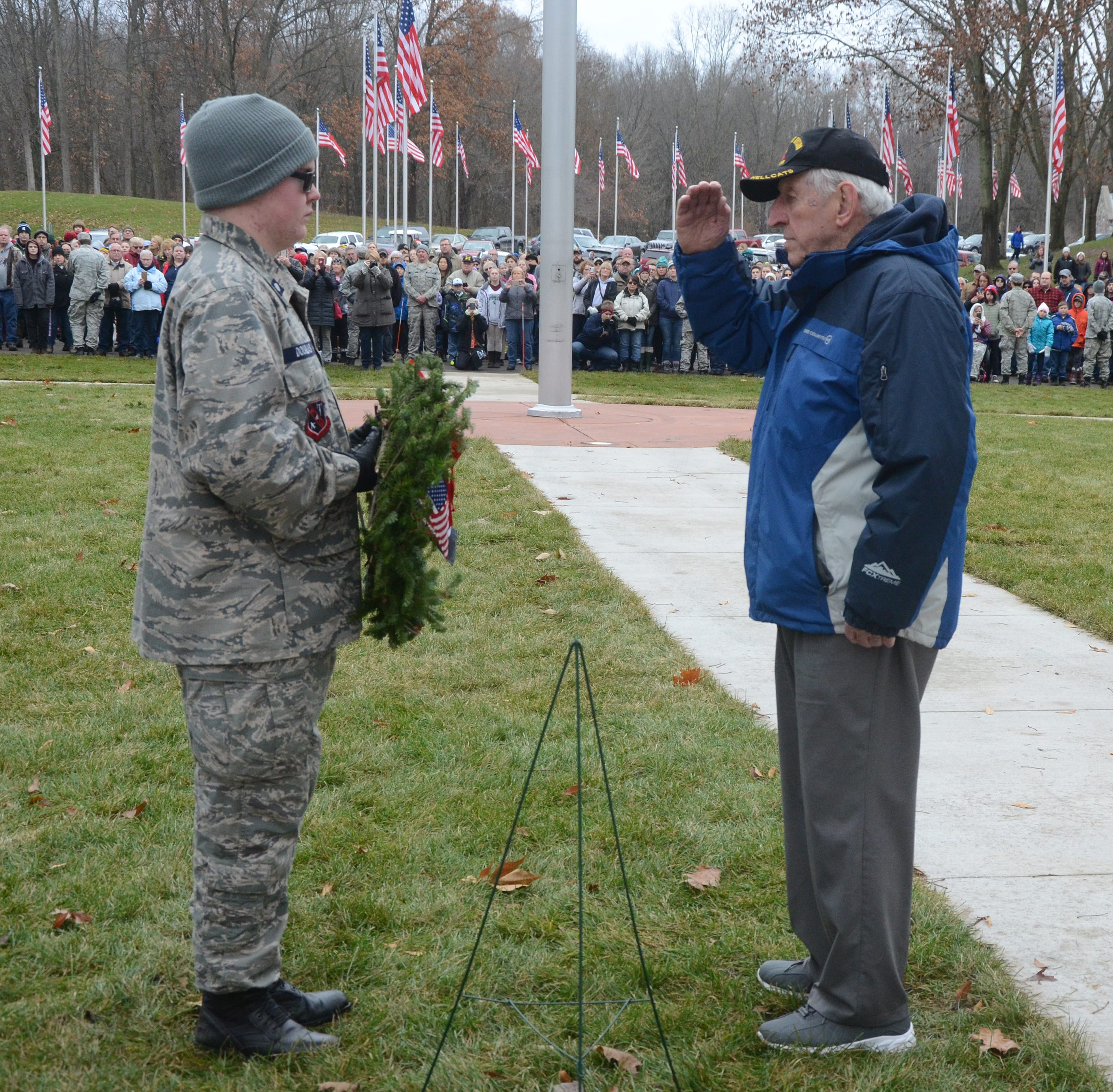 People gather at Fort Custer Cemetery to honor veterans with wreaths