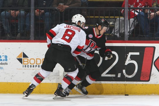 The Binghamton Devils' Josh Jacobs checks a Belliville Senator during Saturday's game at Floyd L. Maines Veterans Memorial Arena. The Devils won, 3-1.
