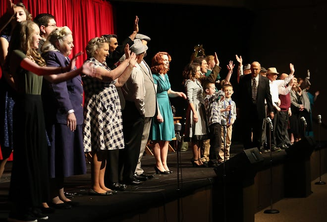 """The cast of """"It's a Wonderful Life"""" rehearses curtain call at Christ the Rock Community Church in Port Orchard on Saturday, Dec. 15, 2018."""