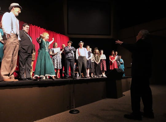 """Director Doug Bear gives instructions to the cast of """"It's a Wonderful Life"""" at Christ the Rock Community Church in Port Orchard on Saturday, Dec. 15, 2018."""