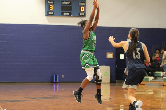 """Danasia """"Piggy"""" Dumas led the Warren Wilson College Owls in scoring this season with 24 points per game."""