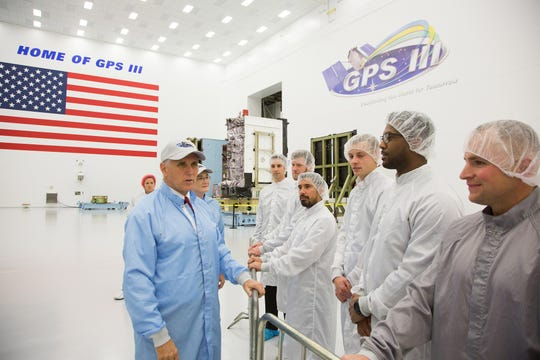 On Oct. 26, 2017, Vice President Mike Pence and Secretary of the Air Force Heather Wilson (in ball caps) greeted Lockheed Martin GPS III employees in their clean room near Denver, Colorado. Both dignitaries signed thermal blankets flying on the first GPS III satellite, scheduled to launch Dec. 18 from Cape Canaveral on a SpaceX Falcon 9 rocket.