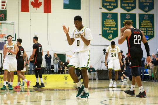 Vermont guard Stef Smith (0) cheers during a time out during the men's basketball game between the Northeastern Huskies and the Vermont Catamounts at Patrick Gym on Sunday afternoon December 16, 2018 in Burlington.