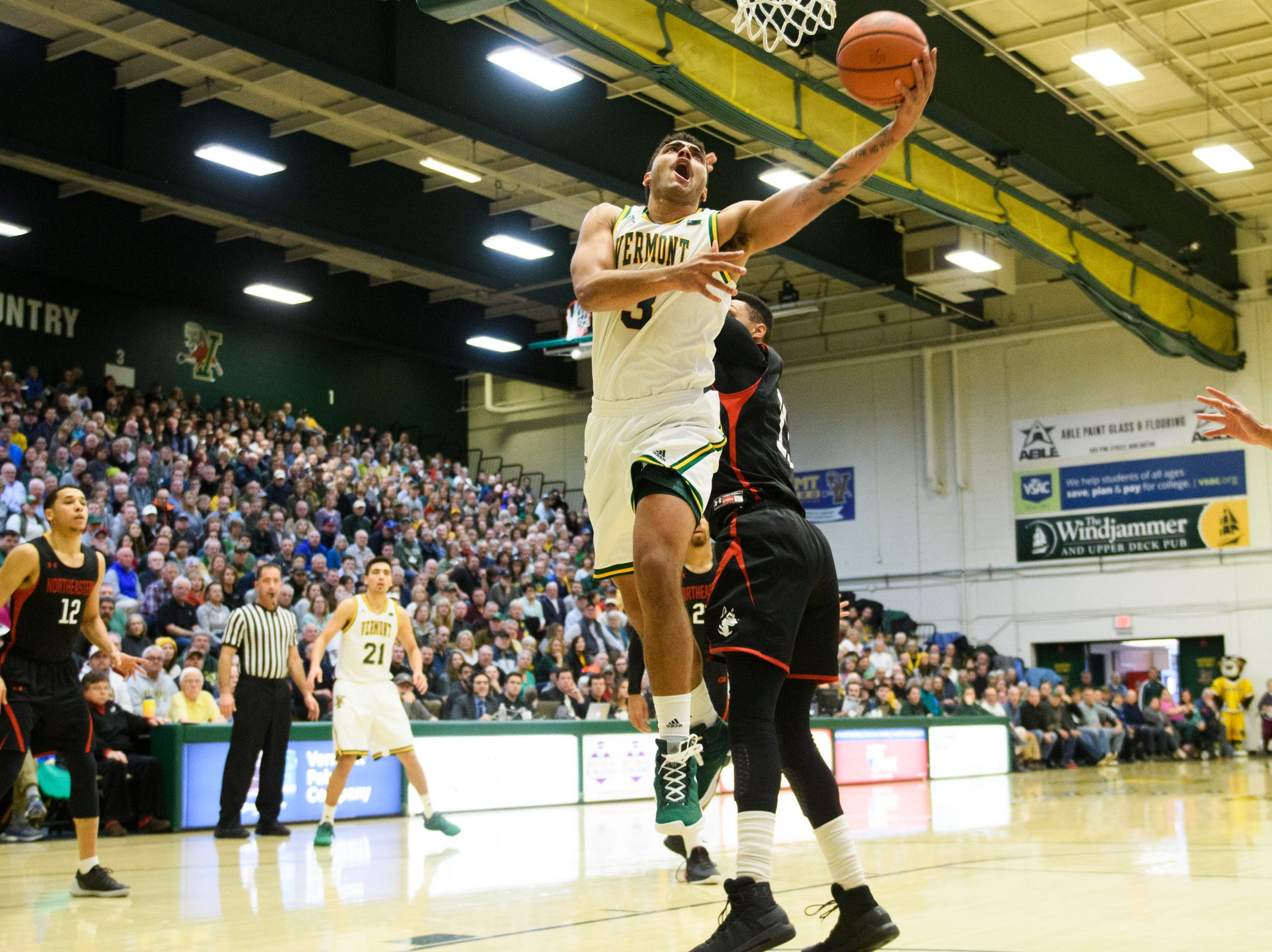 Vermont forward Anthony Lamb (3) leaps for a lay up during the men's basketball game between the Northeastern Huskies and the Vermont Catamounts at Patrick Gym on Sunday afternoon December 16, 2018 in Burlington.