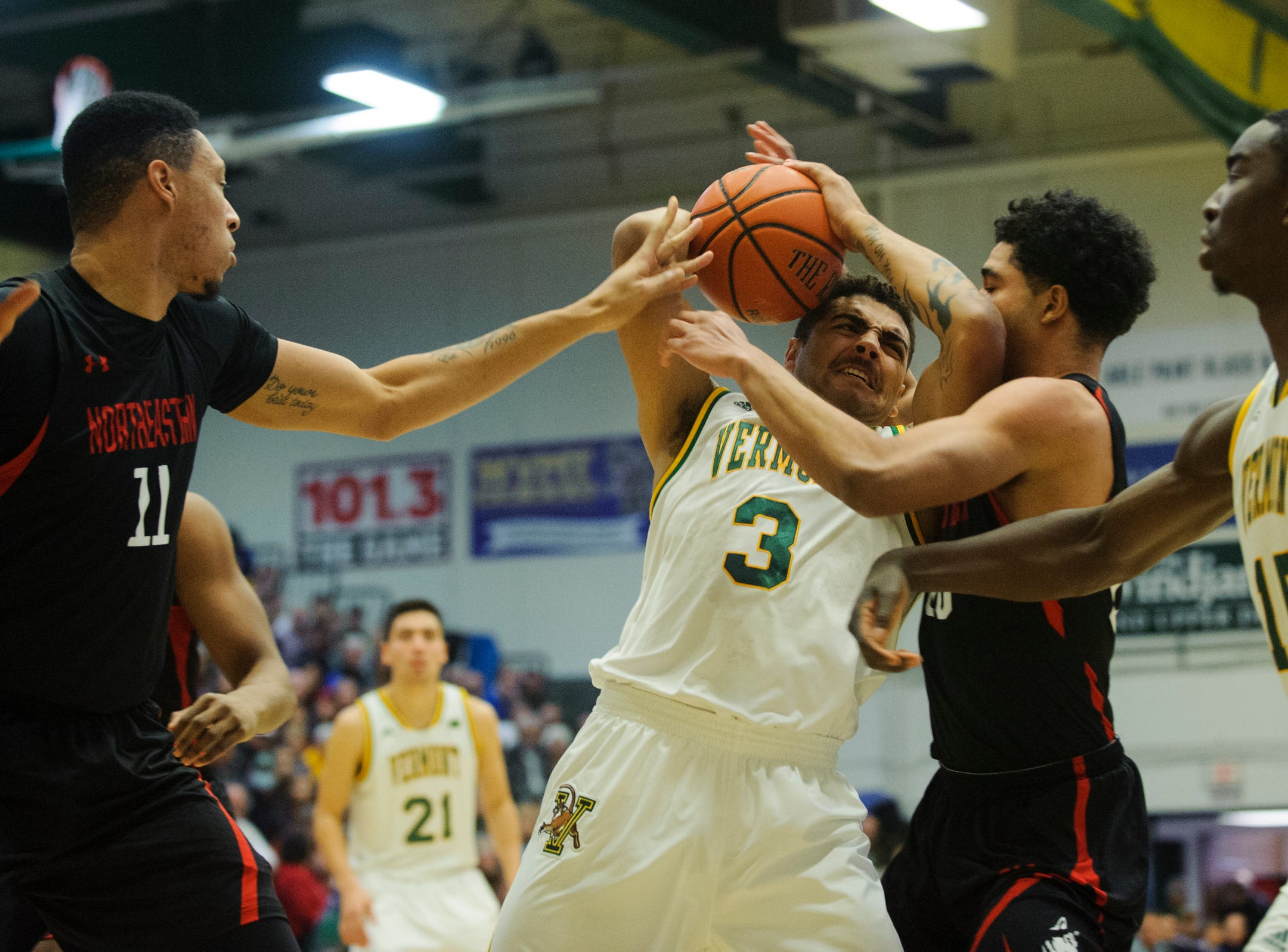Vermont forward Anthony Lamb (3) fights for the ball during the men's basketball game between the Northeastern Huskies and the Vermont Catamounts at Patrick Gym on Sunday afternoon December 16, 2018 in Burlington.