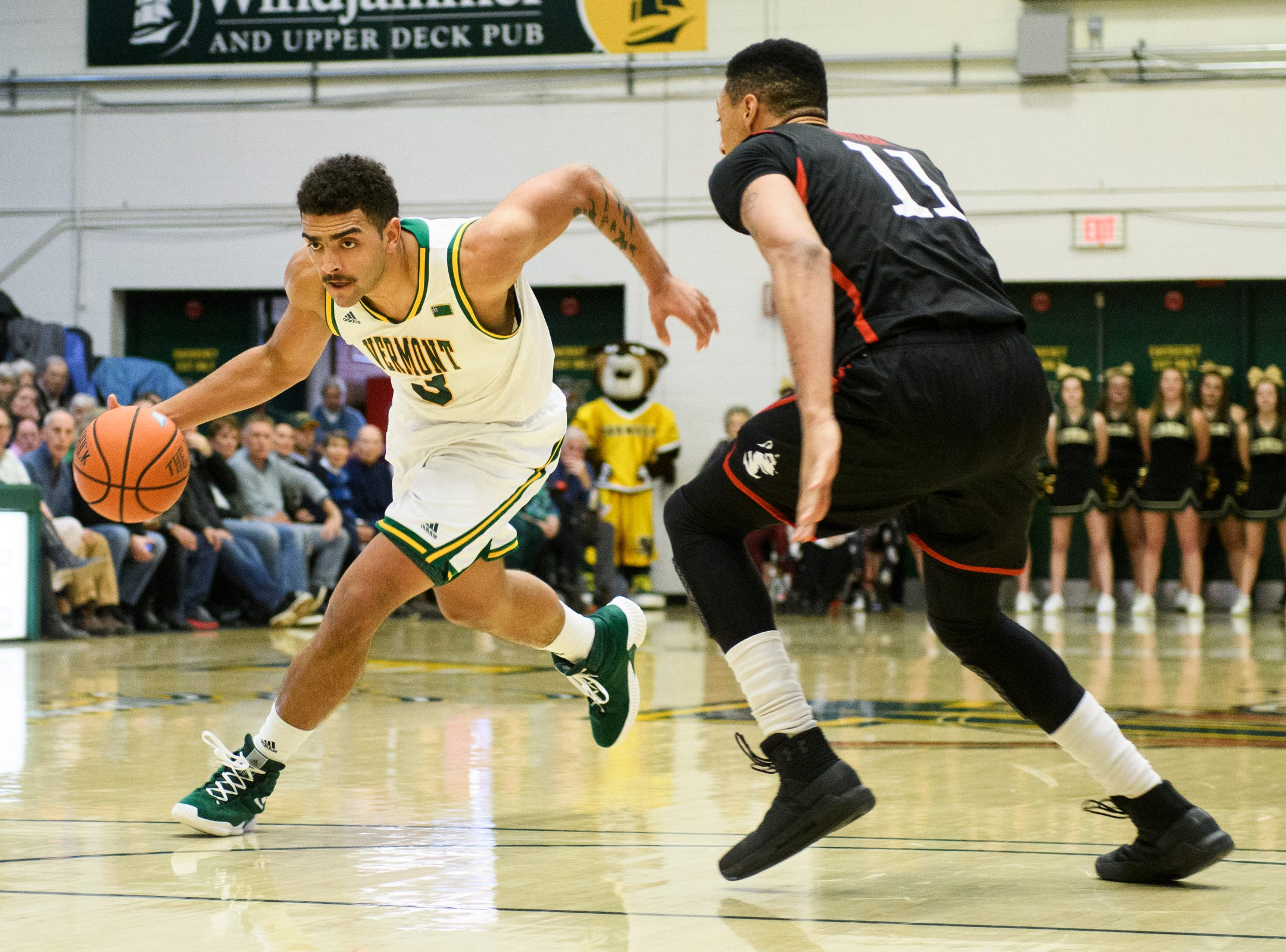 Vermont forward Anthony Lamb (3) drives to the hoop past Northeastern's Jeremy Miller (11) during the men's basketball game between the Northeastern Huskies and the Vermont Catamounts at Patrick Gym on Sunday afternoon December 16, 2018 in Burlington.