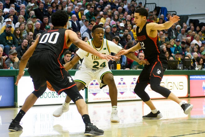 Vermont guard Ben Shungu (24) looks to pass the ball during the men's basketball game between the Northeastern Huskies and the Vermont Catamounts at Patrick Gym on Sunday afternoon December 16, 2018 in Burlington.