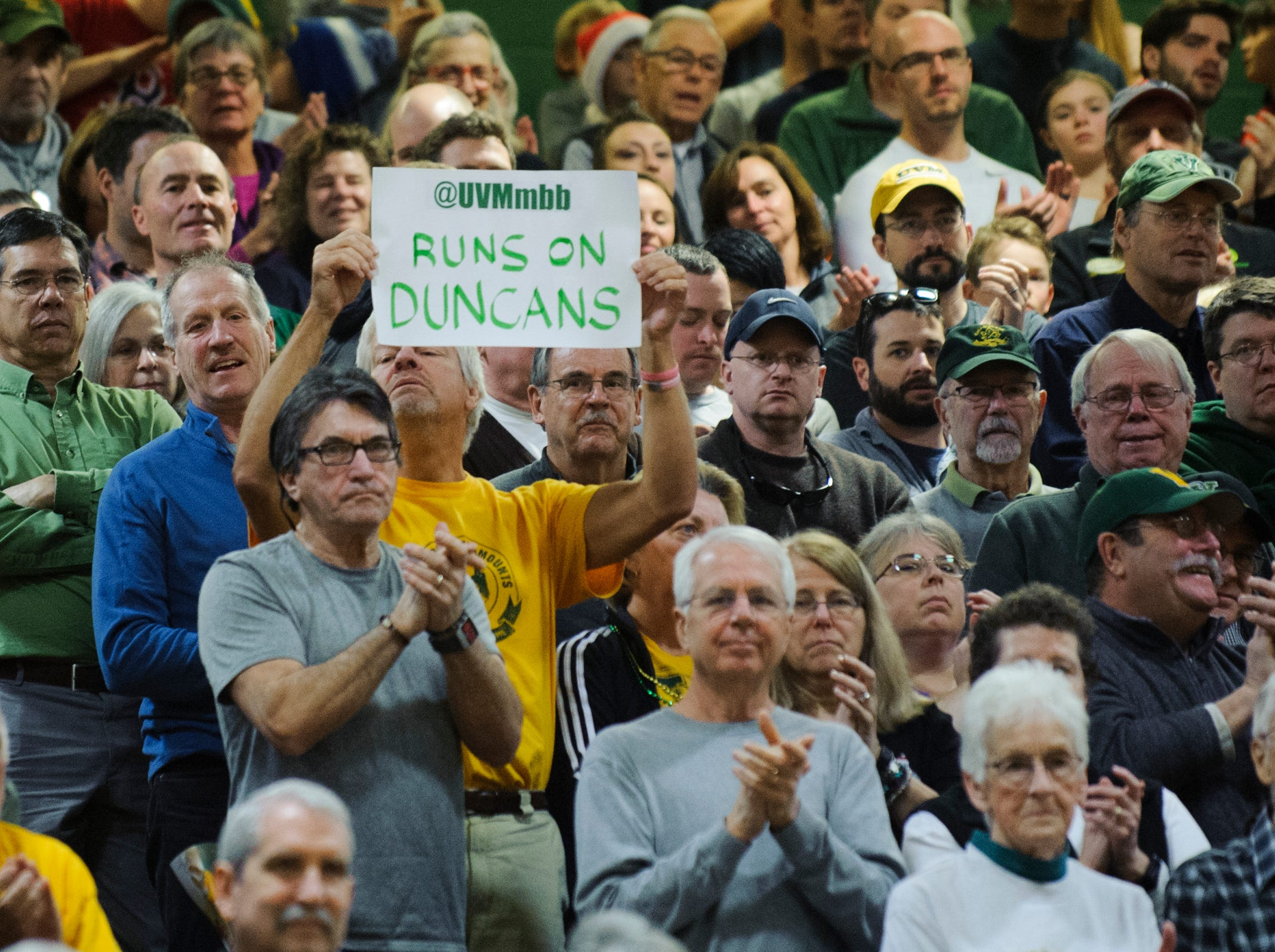 A Vermont fan holds p a sign for the Duncan brothers during the men's basketball game between the Northeastern Huskies and the Vermont Catamounts at Patrick Gym on Sunday afternoon December 16, 2018 in Burlington.