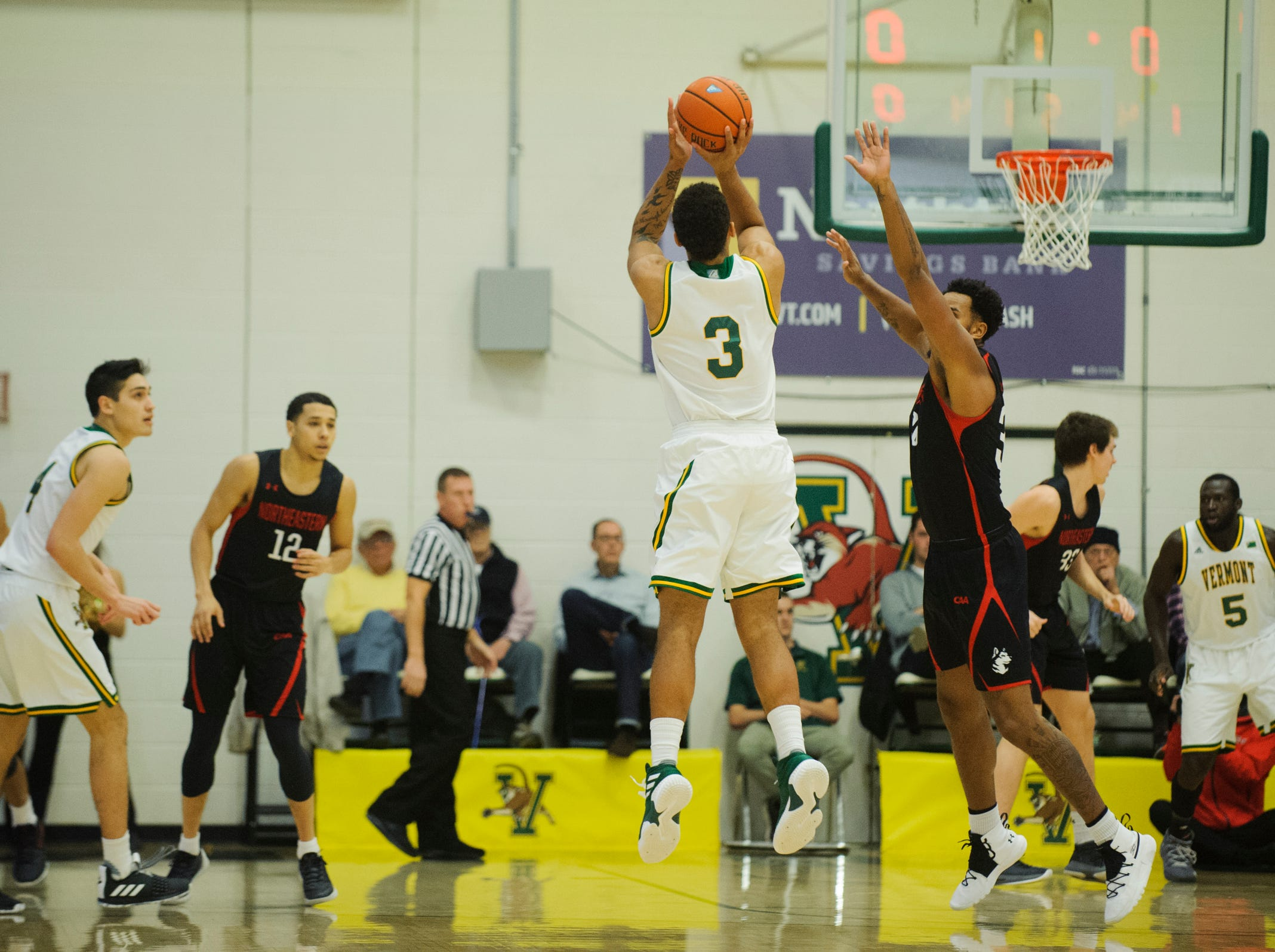 Vermont forward Anthony Lamb (3) shoots a three pointer during the men's basketball game between the Northeastern Huskies and the Vermont Catamounts at Patrick Gym on Sunday afternoon December 16, 2018 in Burlington.
