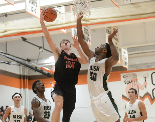 Haddonfield's Aiden Blake takes the ball to the hoop against Camden Catholic's Uche Okafor during a 47-37 win in the Jimmy V Tournament at Cherokee High School, Saturday, Dec. 15, 2018.