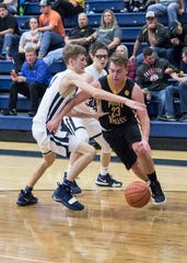 Paint Valley's Caden Grubb dribbles the ball during a game against Adena in Frankfort, Ohio during the 2018-19 season.