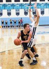 Paint Valley senior Caden Grubb looks for an opening to pass so Paint Valley can score against Adena Saturday night in Frankfort, Ohio. Adena defeated Paint Valley 67-57.