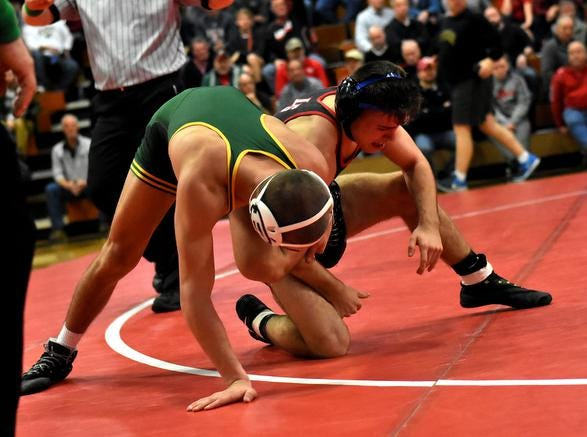 Jake Niffenegger of LaSalle and Bryce Hepner of St. Edward tangle in the 138lb class, December 15, 2018.