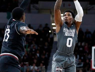 Mississippi State guard Nick Weatherspoon (0) shoots a three-point basket during the first half of an NCAA college basketball game against Cincinnati in Starkville, Miss., Saturday, Dec. 15, 2018. (AP Photo/Rogelio V. Solis)