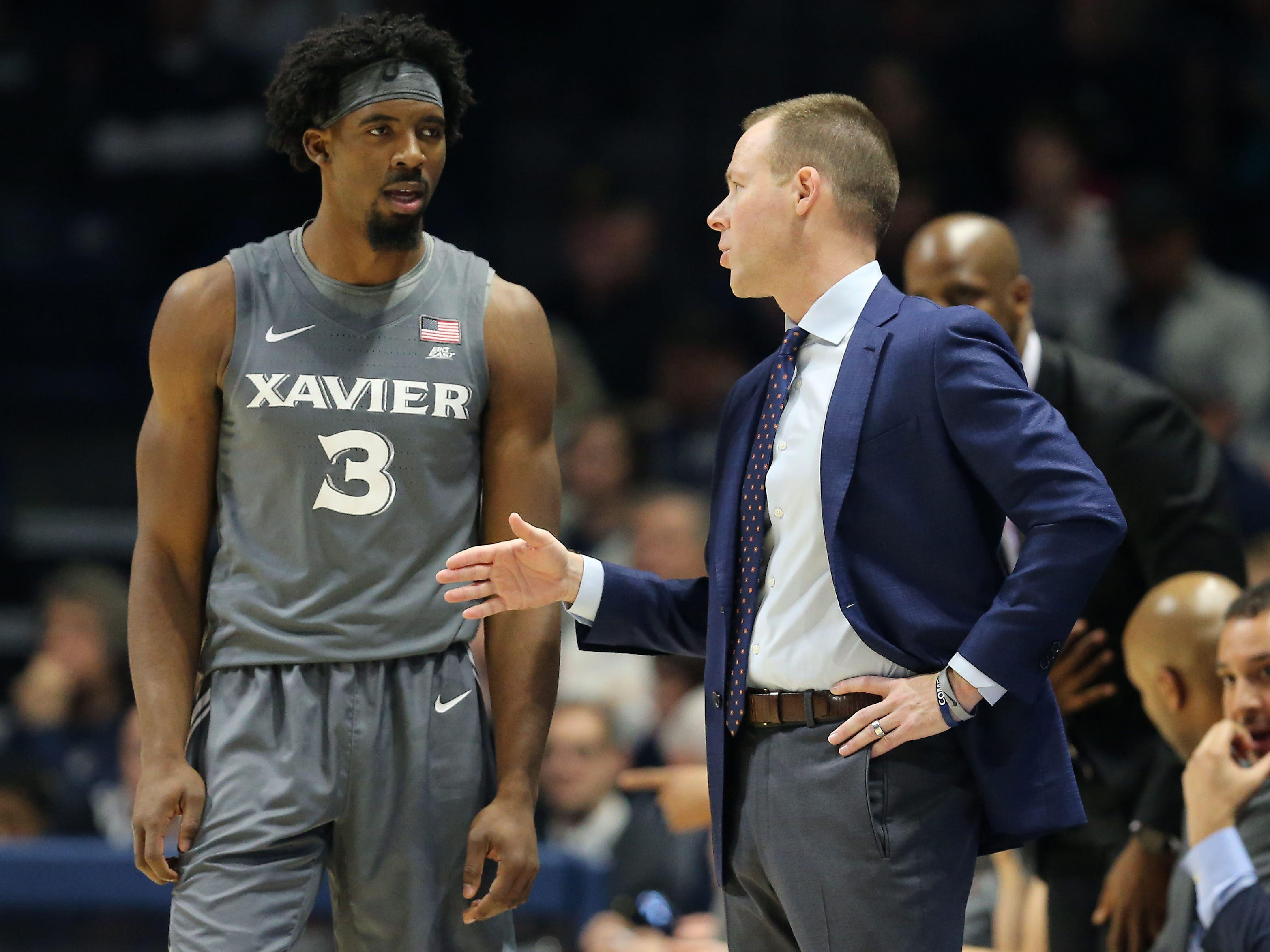 Xavier Musketeers head coach Travis Steele, right, talks with Xavier Musketeers guard Quentin Goodin (3) in the first half of an NCAA college basketball game, Saturday, Dec. 15, 2018, at Cintas Center in Cincinnati, Ohio