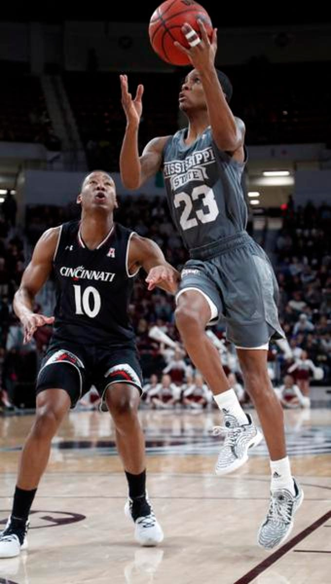 Mississippi State guard Tyson Carter (23) attempts a layup past Cincinnati guard Rashawn Fredericks (10) during the first half of an NCAA college basketball game in Starkville, Miss., Saturday, Dec.15, 2018. (AP Photo/Rogelio V. Solis)