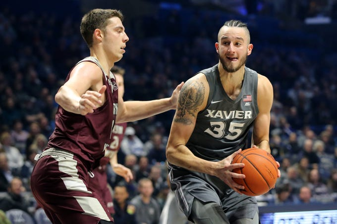 Xavier Musketeers forward Zach Hankins (35) spins toward the basket as Eastern Kentucky Colonels forward Nick Mayo (10) defends in the first half of an NCAA college basketball game, Saturday, Dec. 15, 2018, at Cintas Center in Cincinnati, Ohio
