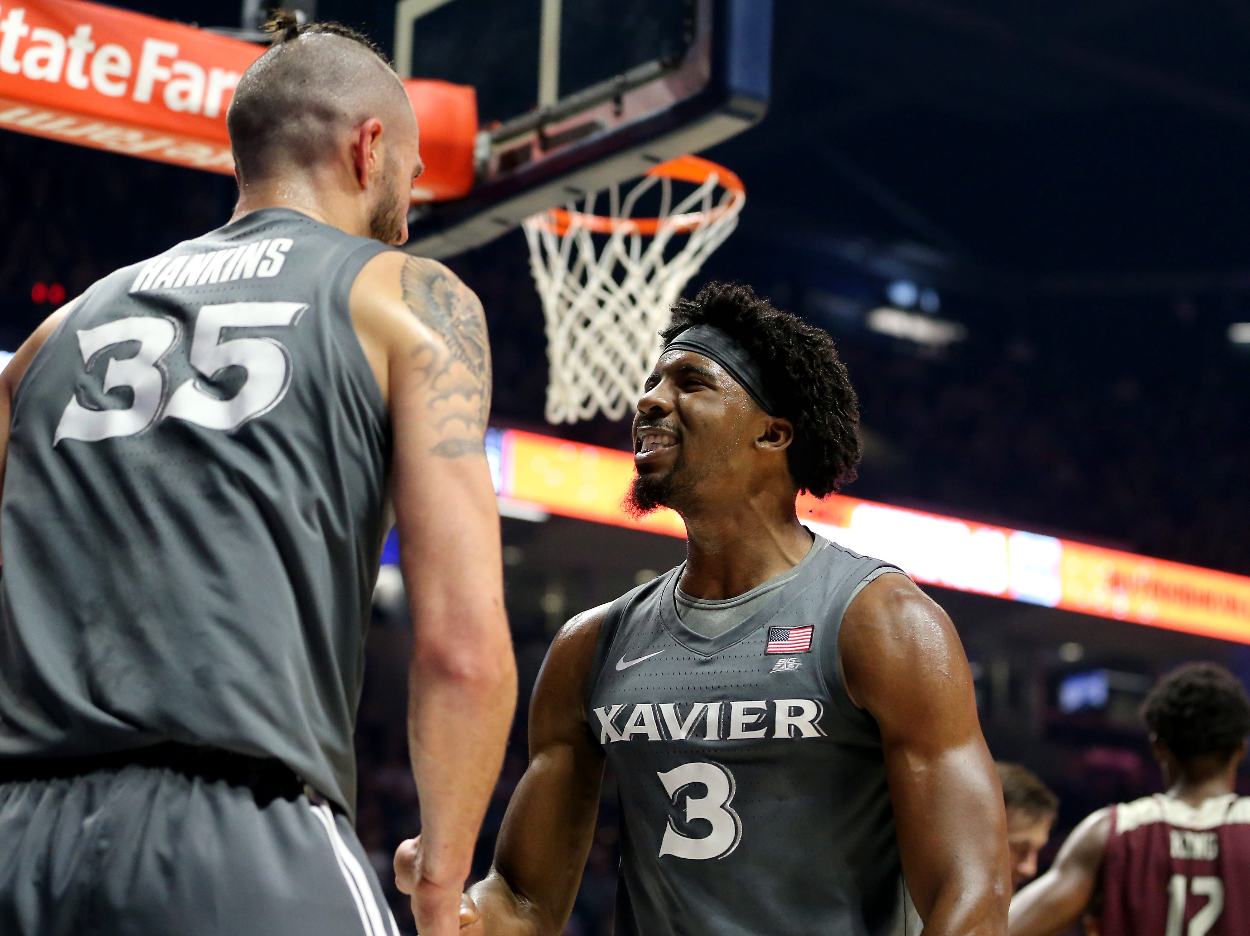 Xavier Musketeers guard Quentin Goodin (3) congratulates Xavier Musketeers forward Zach Hankins (35) on a made basket and a foul in the first half of an NCAA college basketball game Eastern Kentucky Colonels, Saturday, Dec. 15, 2018, at Cintas Center in Cincinnati, Ohio