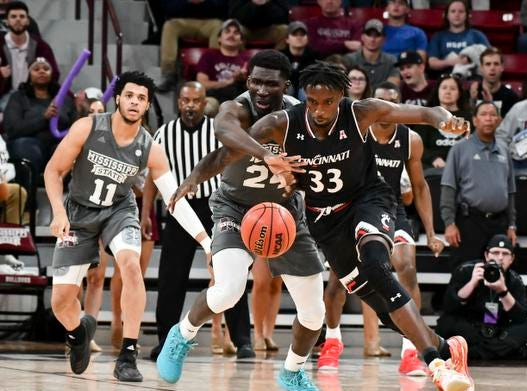 Dec 15, 2018; Starkville, MS, USA; Mississippi State Bulldogs forward Abdul Ado (24) and Cincinnati Bearcats center Nysier Brooks (33) battle for the ball during the first half at Humphrey Coliseum. Mandatory Credit: Matt Bush-USA TODAY Sports