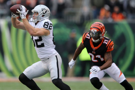 Oakland Raiders wide receiver Jordy Nelson (82) catches a pass as Cincinnati Bengals defensive back Darqueze Dennard (21) defends in the first quarter of a Week 15 NFL football game, Sunday, Dec. 16, 2018, at Paul Brown Stadium in Cincinnati.