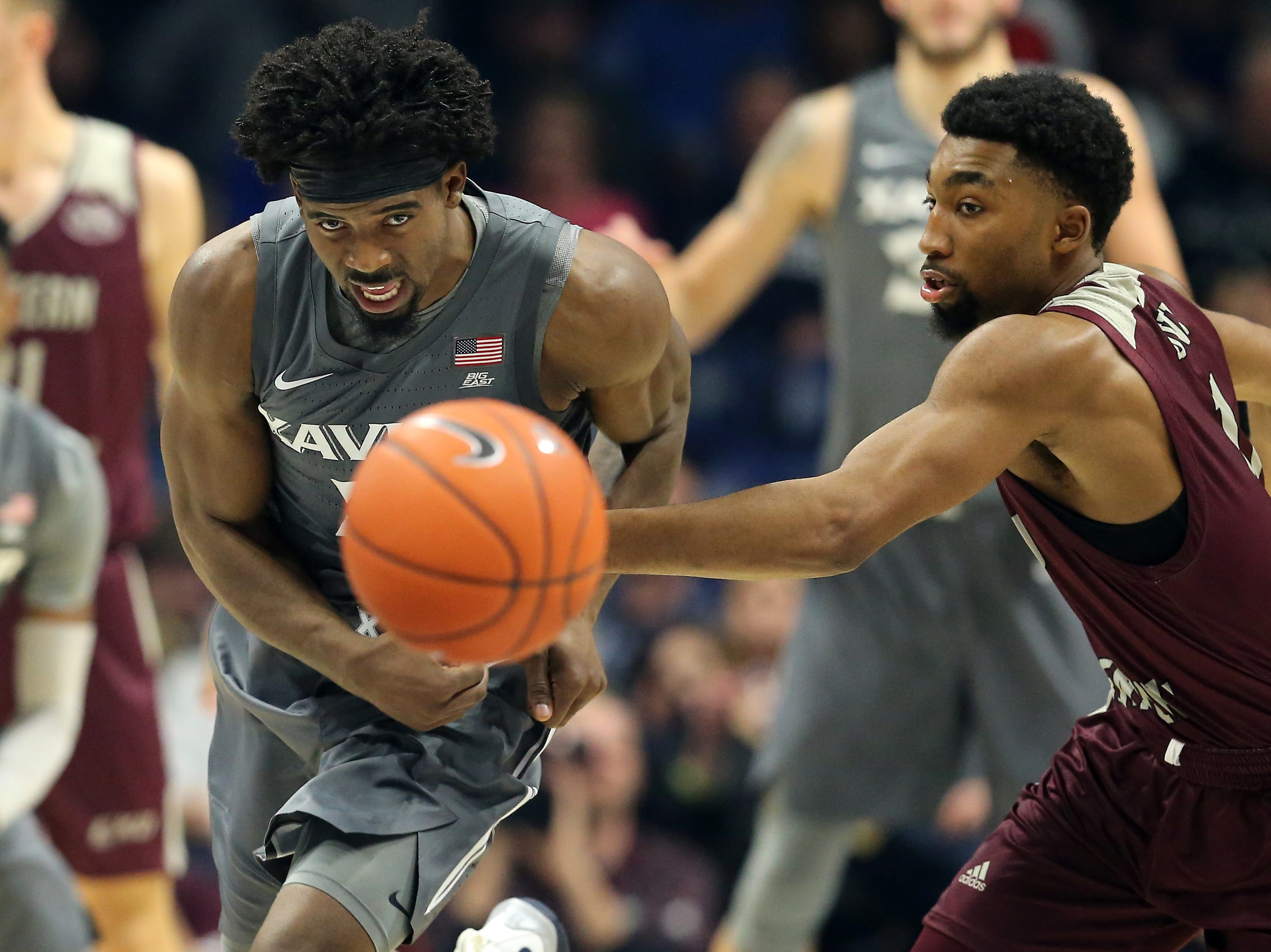 Xavier Musketeers forward Tyrique Jones (0) steals the ball away from Eastern Kentucky Colonels guard Jomaru Brown (11) in the first half of an NCAA college basketball game, Saturday, Dec. 15, 2018, at Cintas Center in Cincinnati, Ohio