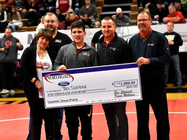 Trey Sizemore (center) is flanked by his parents and schoo staff from LaSalle while receiving a $1,000.00 scholar athlete award from Northgate Ford, December 15, 2018.