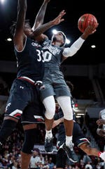Mississippi State guard Nick Weatherspoon (0) attempts a layup under the block of Cincinnati center Nysier Brooks (33) during the first half of an NCAA college basketball game in Starkville, Miss., Saturday, Dec. 15, 2018. (AP Photo/Rogelio V. Solis)