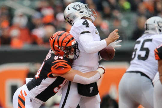 Cincinnati Bengals defensive end Sam Hubbard (94) sacks and causes a fumble of Oakland Raiders quarterback Derek Carr (4) in the first quarter of a Week 15 NFL football game, Sunday, Dec. 16, 2018, at Paul Brown Stadium in Cincinnati.