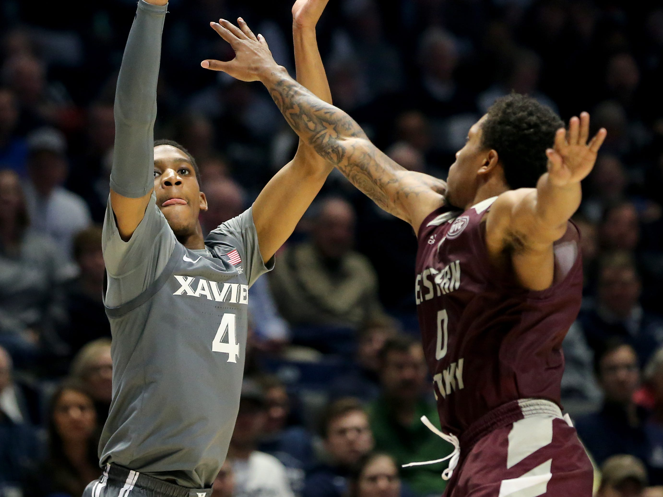 Xavier Musketeers guard Elias Harden (4) rises for a shot as Eastern Kentucky Colonels guard Dujuanta Weaver (0) defends in the second half of an NCAA college basketball game, Saturday, Dec. 15, 2018, at Cintas Center in Cincinnati, Ohio