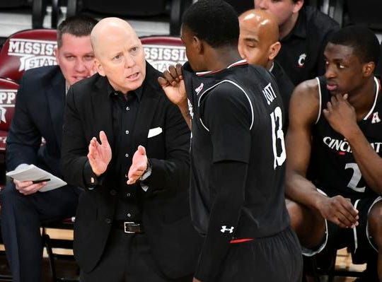 Dec 15, 2018; Starkville, MS, USA; Cincinnati Bearcats head coach Mick Cronin talks with forward Tre Scott (13) during a timeout in the first half of the game against the Mississippi State Bulldogs at Humphrey Coliseum. Mandatory Credit: Matt Bush-USA TODAY Sports