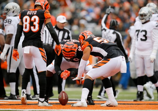 Cincinnati Bengals defensive end Carlos Dunlap (96) celebrates after recovering a fumble in the first quarter of the NFL Week 15 game between the Cincinnati Bengals and the Oakland Raiders at Paul Brown Stadium in downtown Cincinnati on Sunday, Dec. 16, 2018. The Bengals led 20-7 at halftime.