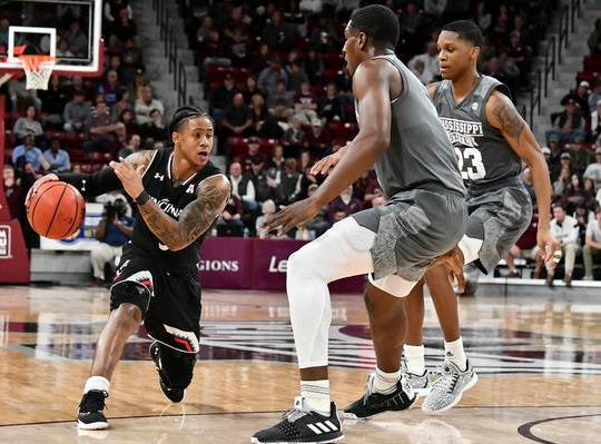Dec 15, 2018; Starkville, MS, USA; Cincinnati Bearcats guard Justin Jenifer (3) handles the ball while being defended by Mississippi State Bulldogs forward Reggie Perry (1) and guard Tyson Carter (23) during the first half at Humphrey Coliseum. Mandatory Credit: Matt Bush-USA TODAY Sports