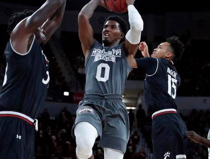 Mississippi State guard Nick Weatherspoon (0) attempts to shoot between Cincinnati defenders during the first half of an NCAA college basketball game in Starkville, Miss., Saturday, Dec. 15, 2018. (AP Photo/Rogelio V. Solis)