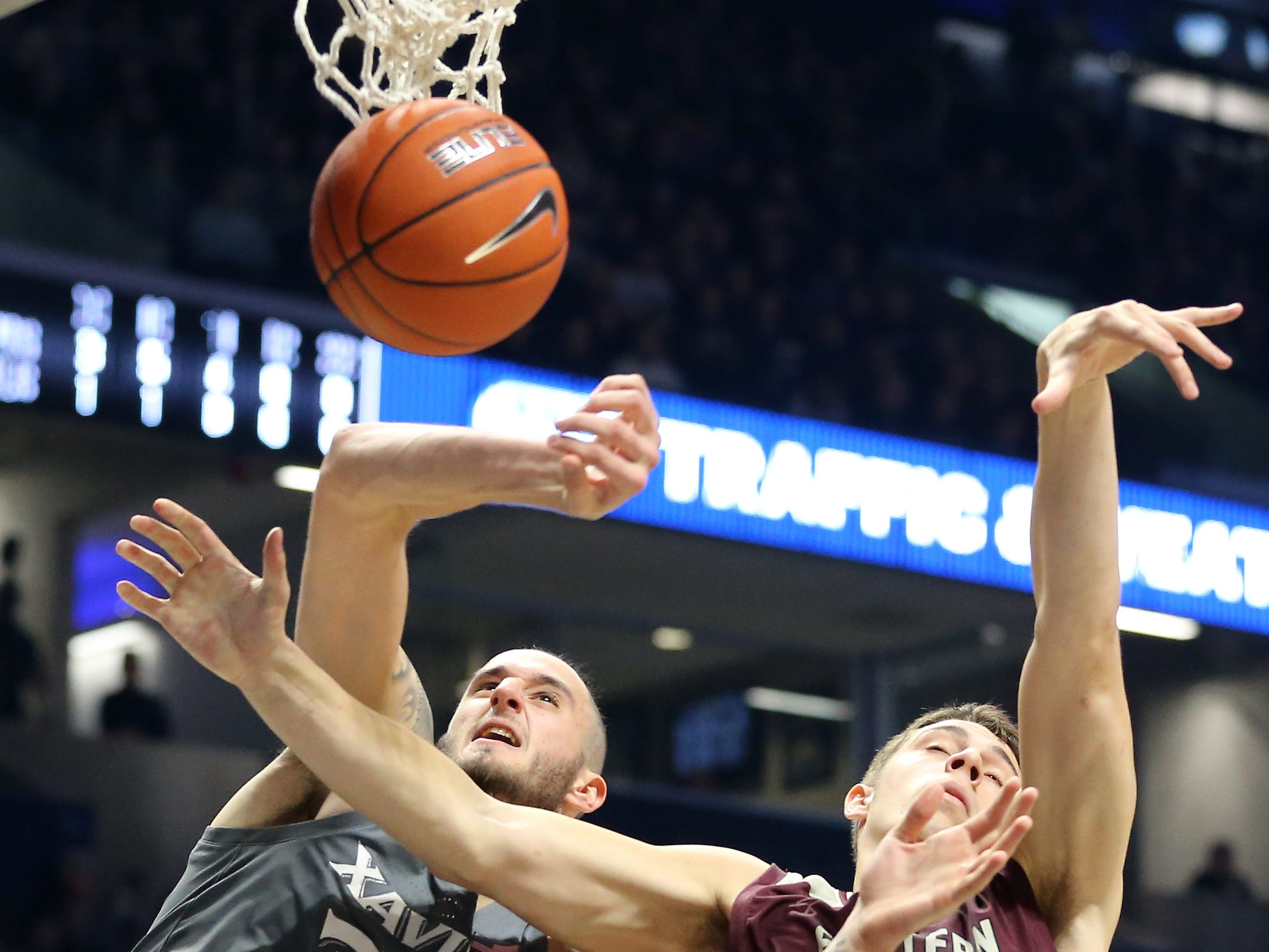Xavier Musketeers forward Zach Hankins (35) and Eastern Kentucky Colonels forward Nick Mayo (10) battle for a rebound in the first half of an NCAA college basketball game, Saturday, Dec. 15, 2018, at Cintas Center in Cincinnati, Ohio