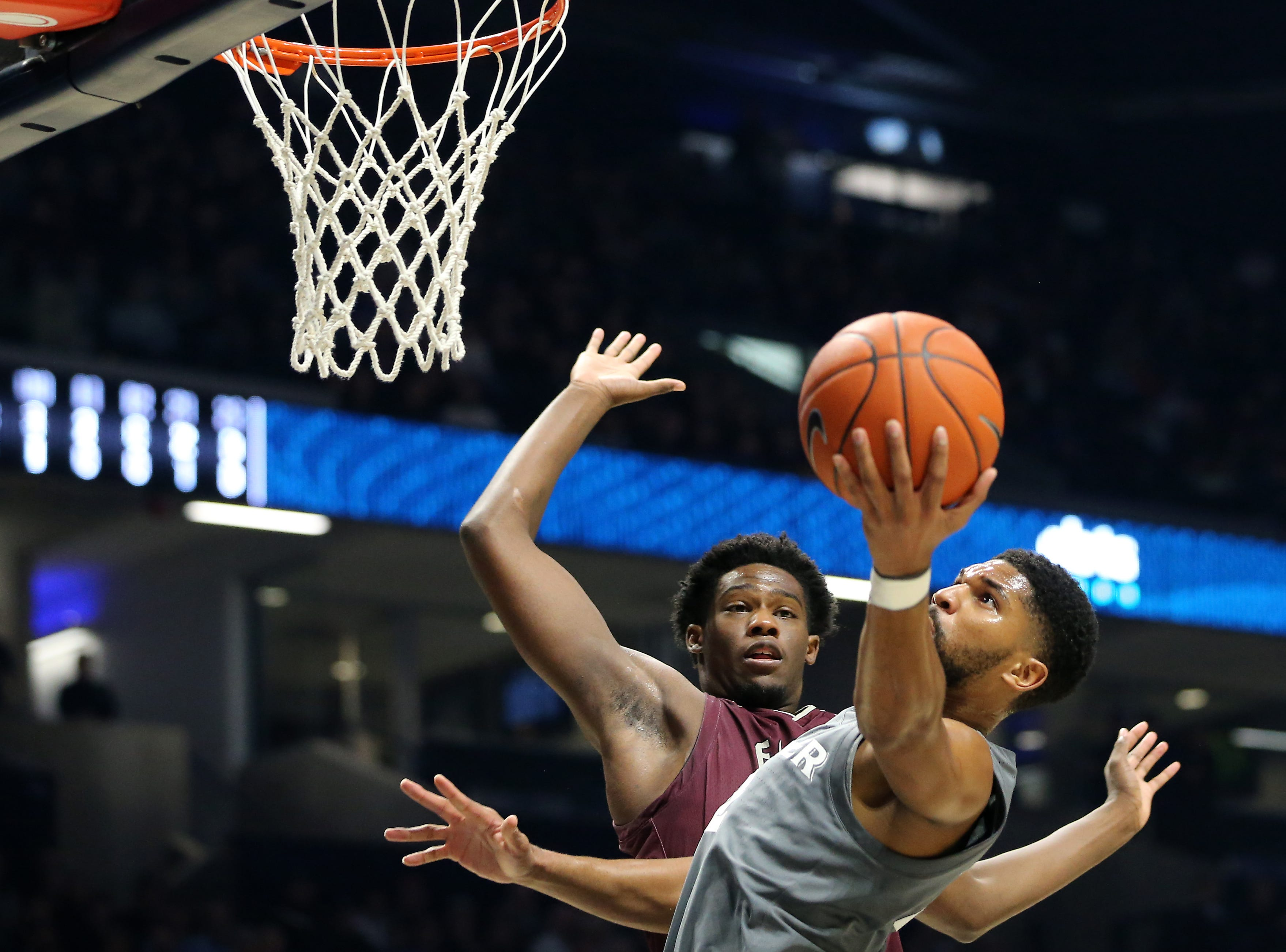 Xavier Musketeers guard Kyle Castlin (2) scores a basket as Eastern Kentucky Colonels forward Tre King (12) defends in the first half of an NCAA college basketball game, Saturday, Dec. 15, 2018, at Cintas Center in Cincinnati, Ohio