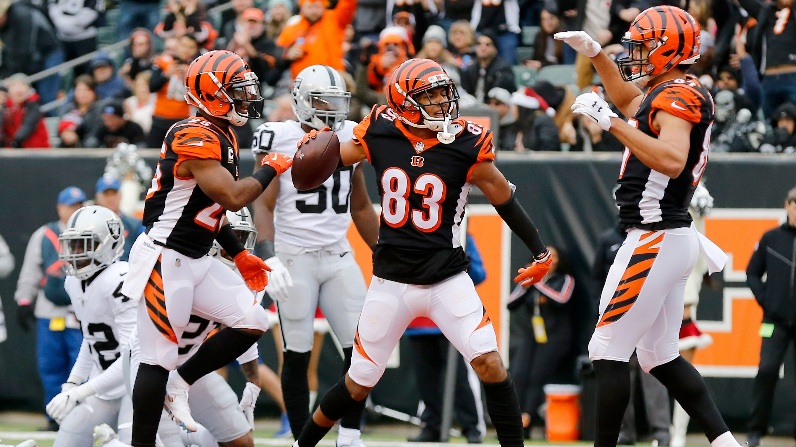 Cincinnati Bengals wide receiver Tyler Boyd (83) celebrates a touchdown reception in the first quarter of the NFL Week 15 game between the Cincinnati Bengals and the Oakland Raiders at Paul Brown Stadium in downtown Cincinnati on Sunday, Dec. 16, 2018. The Bengals led 20-7 at halftime.