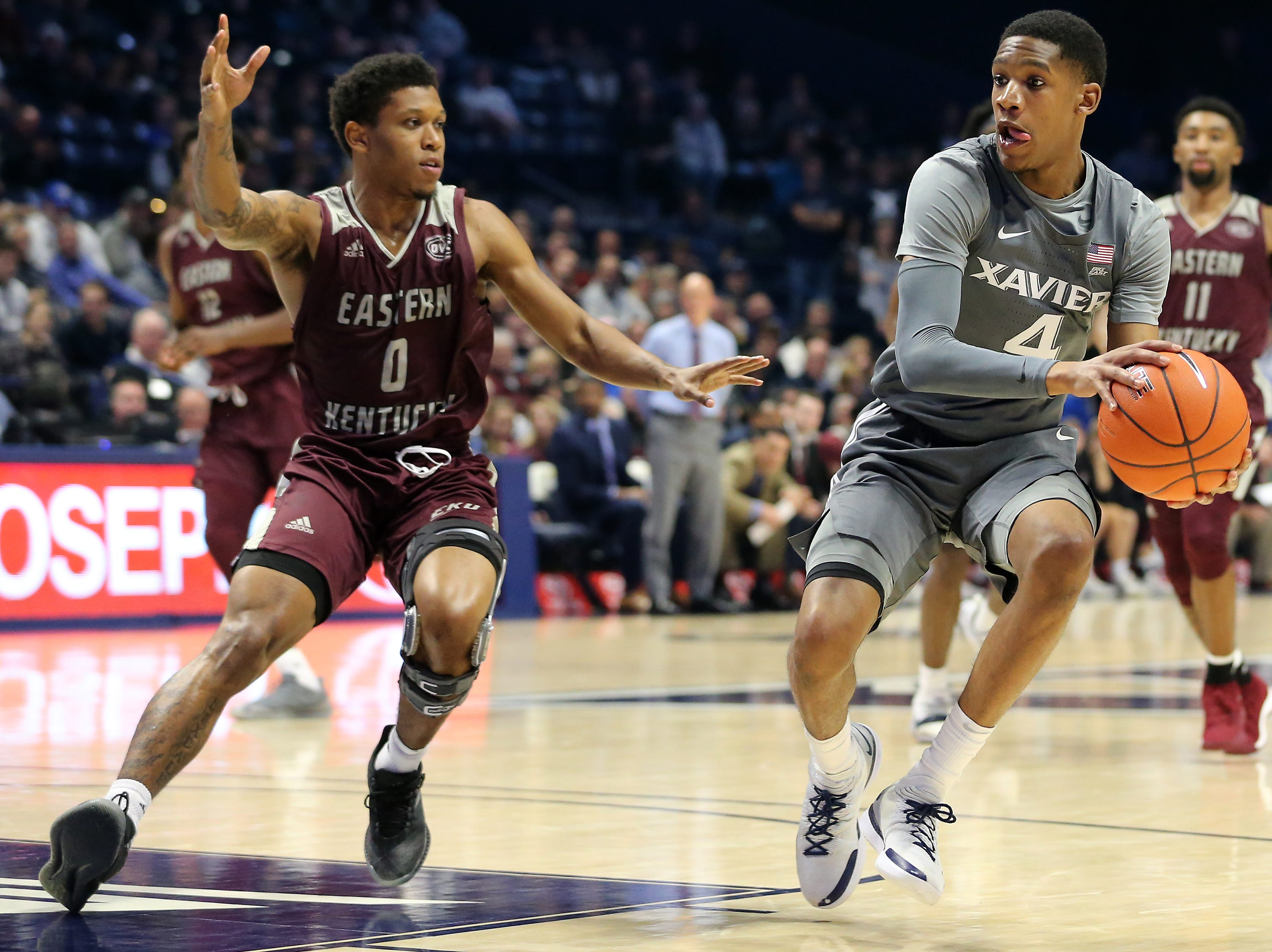 Xavier Musketeers guard Elias Harden (4) looks to pass as Eastern Kentucky Colonels guard Dujuanta Weaver (0) defends in the second half of an NCAA college basketball game, Saturday, Dec. 15, 2018, at Cintas Center in Cincinnati, Ohio
