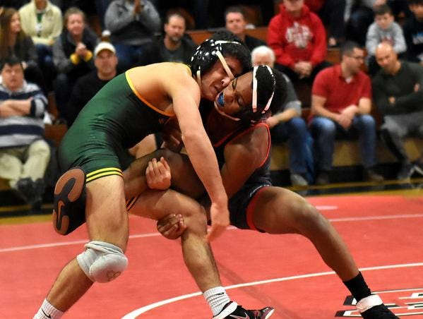 Twan Allen of LaSalle and Angelo Rini of St. Edward dual in the 126lb class, December 15, 2018.