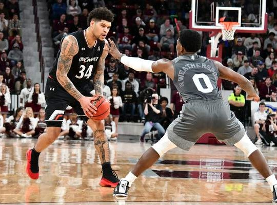 Dec 15, 2018; Starkville, MS, USA; Cincinnati Bearcats guard Jarron Cumberland (34) handles the ball while defended by Mississippi State Bulldogs guard Nick Weatherspoon (0) during the second half at Humphrey Coliseum. Mandatory Credit: Matt Bush-USA TODAY Sports