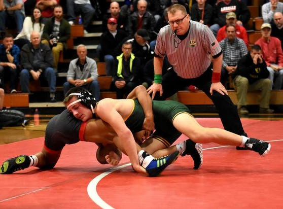 Casey Wiles of LaSalle and Scott Richter of St. Edward battle in the 132lb class during the Lancers and Eagles wrestling dual, December 15, 2018.