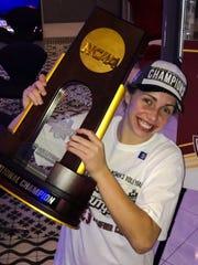 Morgan Hentz with the NCAA trophy Dec. 15