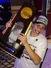 Morgan Hentz with the NCAA trophy Dec. 15