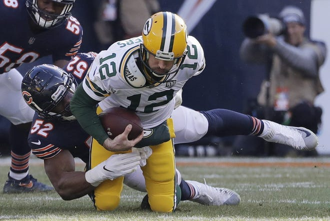 Chicago Bears linebacker Khalil Mack (52) sacks Green Bay Packers quarterback Aaron Rodgers (12) during the first half of an NFL football game Sunday, Dec. 16, 2018, in Chicago.