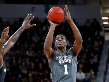Mississippi State forward Reggie Perry (1) attempts a three-point basket against Cincinnati during the first half of an NCAA college basketball game in Starkville, Miss., Saturday, Dec. 15, 2018. (AP Photo/Rogelio V. Solis)