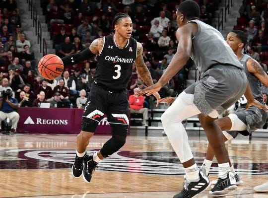 Dec 15, 2018; Starkville, MS, USA; Cincinnati Bearcats guard Justin Jenifer (3) handles the ball while defended by Mississippi State Bulldogs forward Reggie Perry (1) and  guard Tyson Carter (23) during the first half at Humphrey Coliseum. Mandatory Credit: Matt Bush-USA TODAY Sports