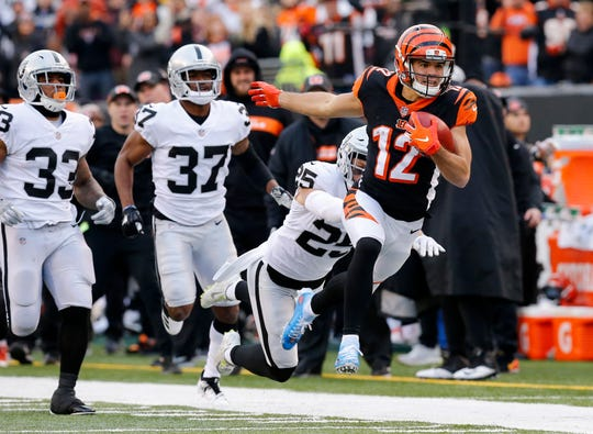 Cincinnati Bengals wide receiver Alex Erickson (12) makes a deep kick off return to set up a touchdown drive in the fourth quarter of the NFL Week 15 game between the Cincinnati Bengals and the Oakland Raiders at Paul Brown Stadium in downtown Cincinnati on Sunday, Dec. 16, 2018. The Bengals won the final home game of the season, 30-16.