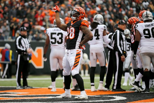 Cincinnati Bengals running back Joe Mixon (28) celebrates his 1-yard touchdown run in the second quarter of the NFL Week 15 game between the Cincinnati Bengals and the Oakland Raiders at Paul Brown Stadium in downtown Cincinnati on Sunday, Dec. 16, 2018. The Bengals led 20-7 at halftime.