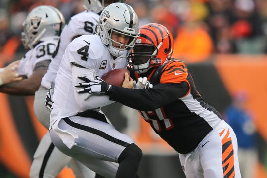Cincinnati Bengals defensive tackle Geno Atkins (97) sacks Oakland Raiders quarterback Derek Carr (4) in the fourth quarter of a Week 15 NFL football game, Sunday, Dec. 16, 2018, at Paul Brown Stadium in Cincinnati. The Cincinnati Bengals won 30-16.
