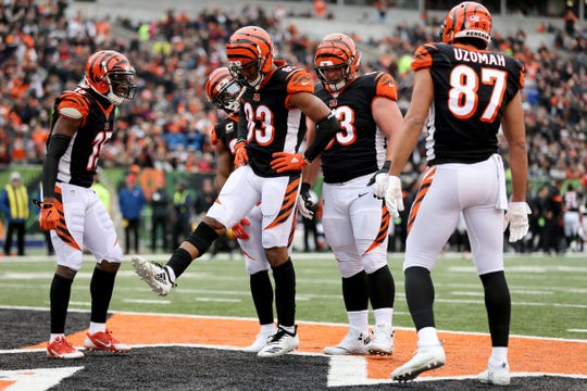Cincinnati Bengals wide receiver Tyler Boyd (83), center, celebrates a touchdown catch in the first quarter of a Week 15 NFL football game, Sunday, Dec. 16, 2018, at Paul Brown Stadium in Cincinnati.