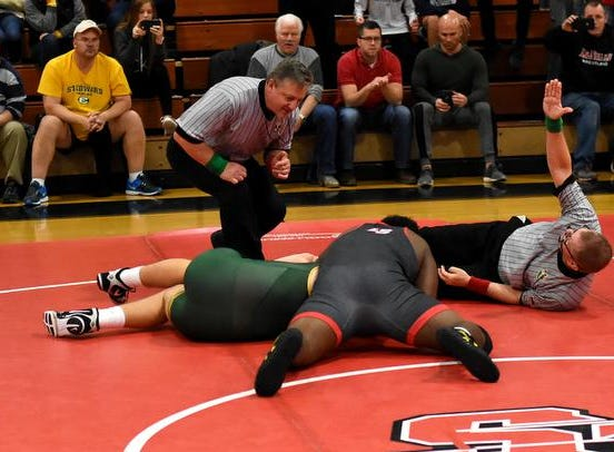 Rob Brown covers Zach Taylor of St. Edward in the 285lb class and scores a pin helping LaSalle to a 35-27 team dual win over the Eagles, December 15, 2018.